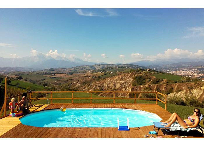 Guests enjoying swimming pool at Casa Amrita, Italy